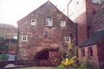 The whater-wheel side, of the mill at Leek - Dec 2001.