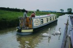 Oxford Canal (Southern Section): Priors Hardwick Bridge No 123, Boat and swan with cygnets - May 1999.