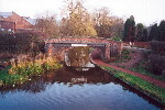 A bridge on The Trent and Mersey Canal with a sign bearing the words 'Welcome to Stone' - Dec 2001.